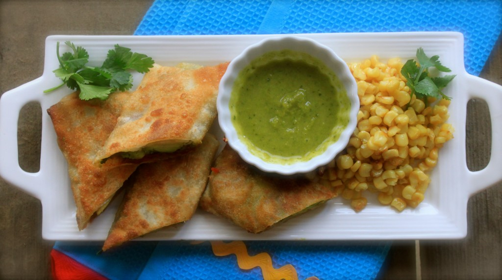 Avocado egg rolls with sweet chilie honey and cilantro get sauced.