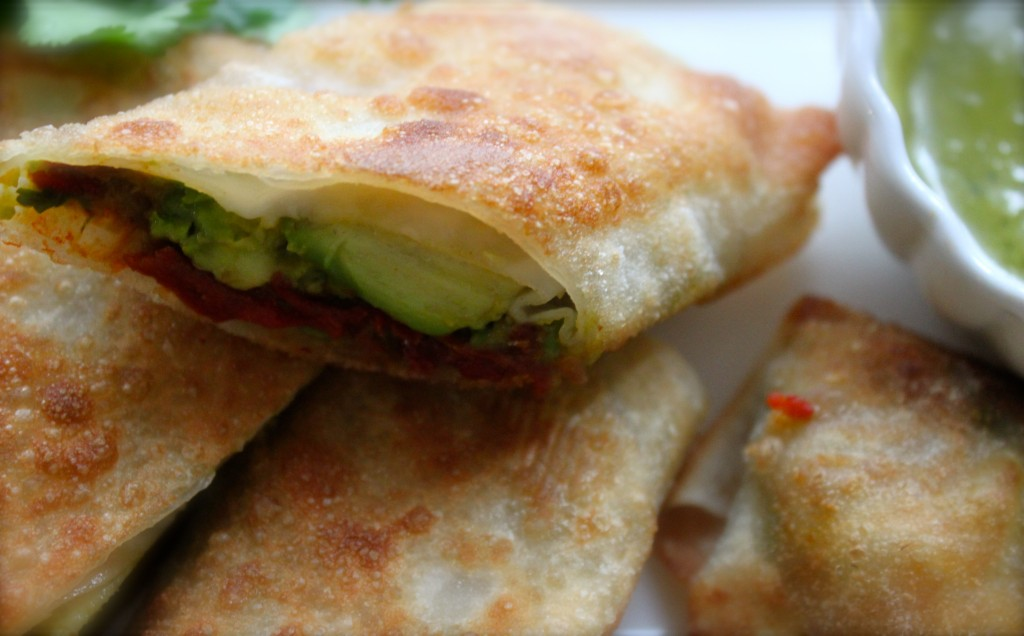 Avocado egg rolls with sweet chilie honey and cilantro get sauced