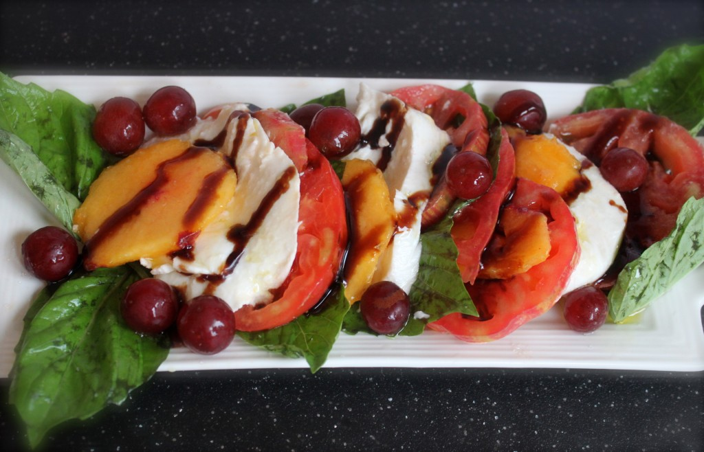 caprese with peach, heirloom and grapes