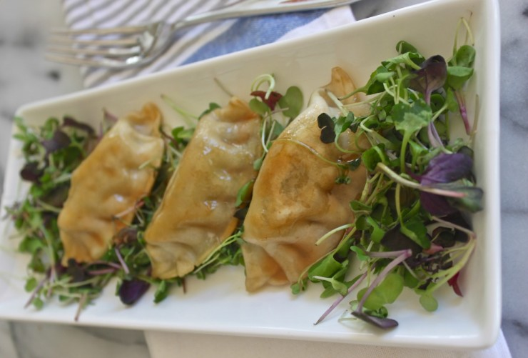 Asian micro green plum dumpling salad