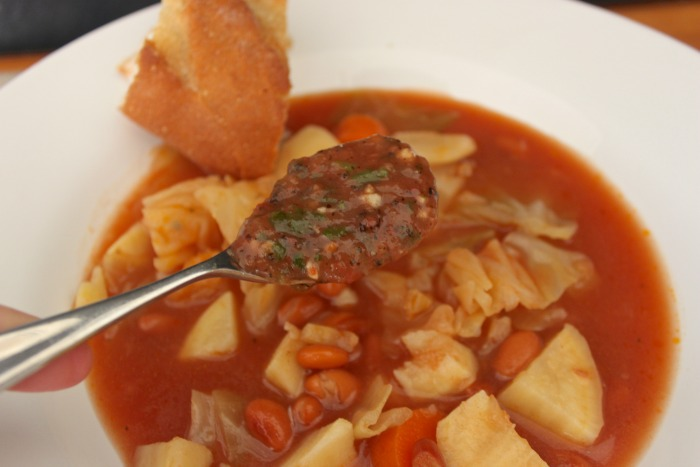basque soup with a spoon of salsa
